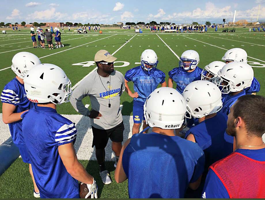 Frenship running backs coach Evan Hearn speaks with his players during summer camp at Frenship High School in Wolfforth. After two years at Hale Center, Hearn joined the coaching staff at Frenship this season. Photo: Courtesy Of Evan Hearn
