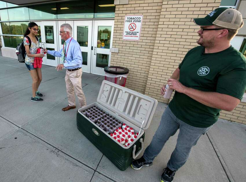 Jeff Bradt, middle, Food Service Director for Capital Region BOCES and Seth McEachron of the Battenkill Creamery hand out milk to students for them to try at the Niskayuna High School on opening day Sept. 5, 2018 in Niskayuna, N.Y. According to information from the school district the Battenkill Creamery is partnering with the Niskayuna High School, will be selling both chocolate milk and mocha milk in the cafeterias. (Skip Dickstein/Times Union)