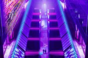 """In a new photo series, Chris Nhut Le has imagined Houston floating among the stars with streets bathed in neon light similar to scenes from """"Blade Runner."""""""