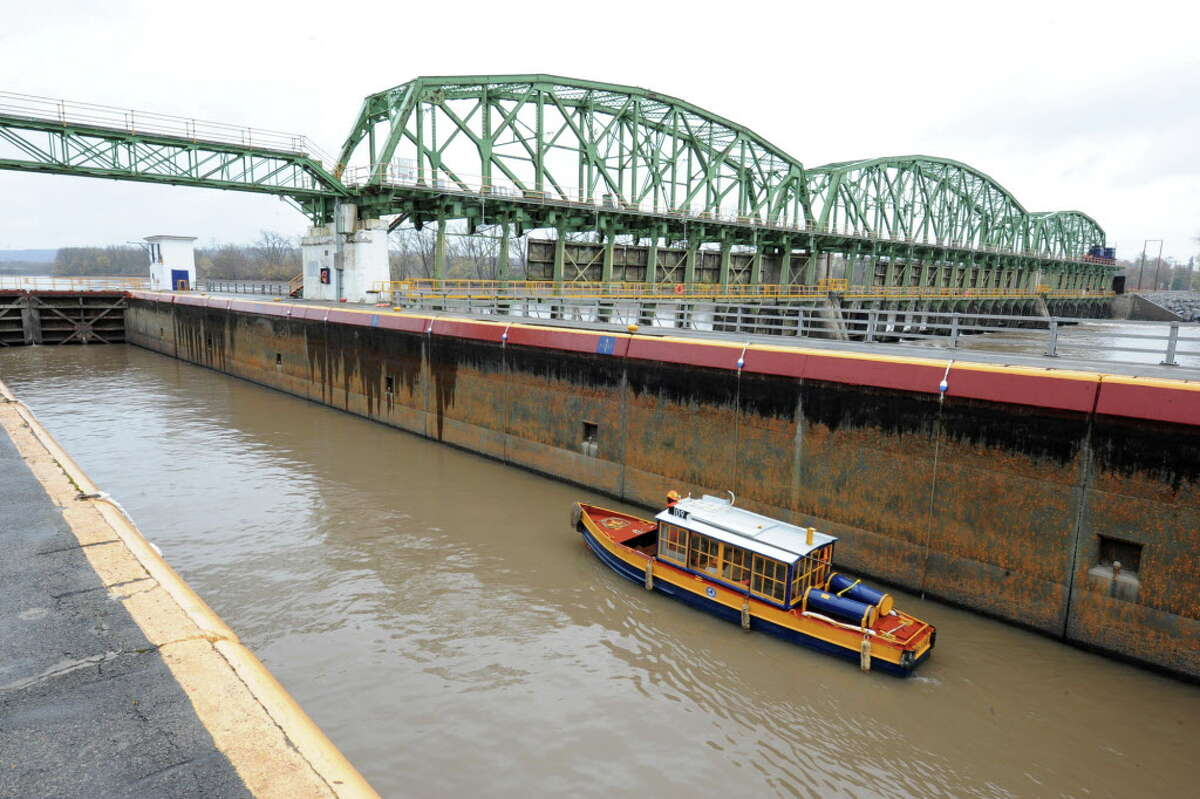 Canal welder J.R. VanValkenburg takes the canal's safety boat through Lock 8 as he heads up to lock 9 of the Erie Canal on the Mohawk River Thursday Nov. 1, 2012 in Scotia, N.Y. Canal workers began lowering uprights and lowering gates as water levels in the system had been lowered to reduce the risk of flooding from Hurricane Sandy. (Lori Van Buren / Times Union)