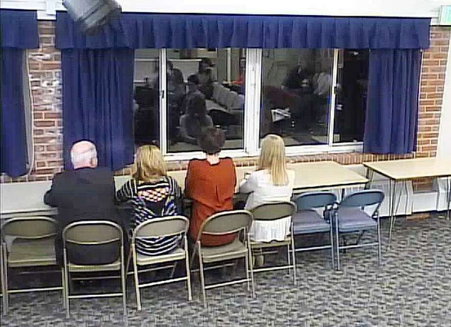 BOE members sit in chairs meant to mimic a bench seating style proposed for the cafeteria at a school board meeting in Darien, CT on Feb. 28, 2017. Photo: Contributed Photo /Contributed Photo / Darien News