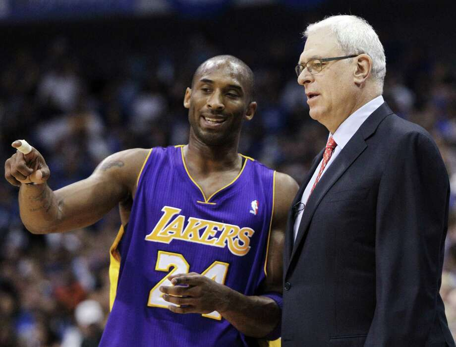 A reader compares and contrasts the exit of Laker Kobe Bryan (with coach Phil Jackson in 2011) with that of Spurs favorite Manu Ginobli. Manu wins. Photo: Associated Press File Photo / AP2011