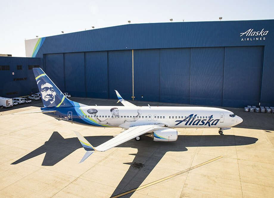 Russell Wilson, Alaska Airlines' Chief Football Officer and also quarterback for the Seattle Seahawks, adorns an airplane debuting the new look Friday on a flight to Denver, where the Hawks will play the Broncos in their Sunday season opener. Photo: Alaska Airlines / This image must be used within the context of the news release it accompanied. Request permission from issuer for other uses.