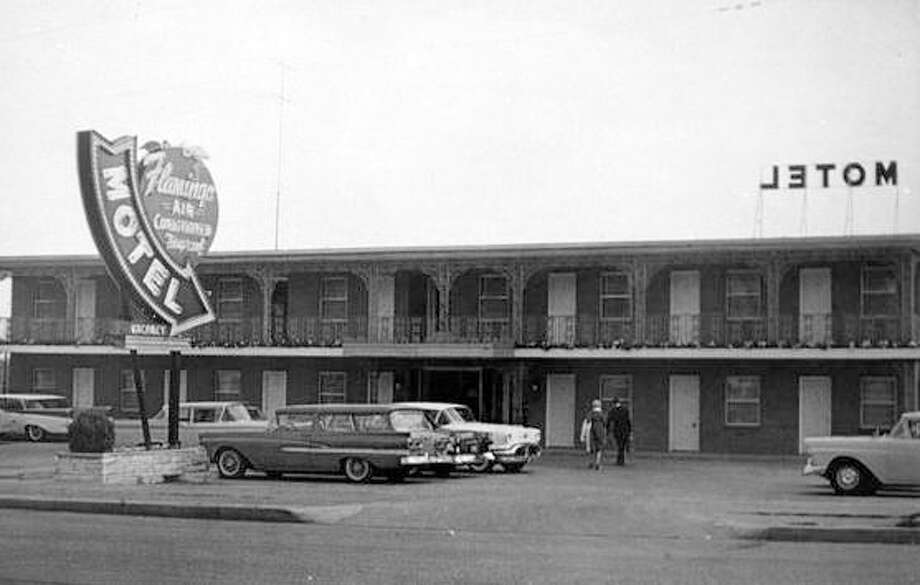 A postcard shows the classic, stylish sign of the Flamingo Motel on Route 67 at Highway 140 at Lewis and Clark Bridge. The advertisement boasts 36 deluxe units with air conditioning and room phones. Photo: File Photo