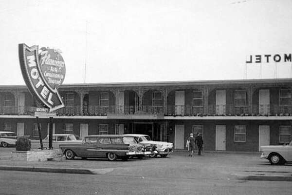 A postcard shows the classic, stylish sign of the Flamingo Motel on Route 67 at Highway 140 at Lewis and Clark Bridge. The advertisement boasts 36 deluxe units with air conditioning and room phones.