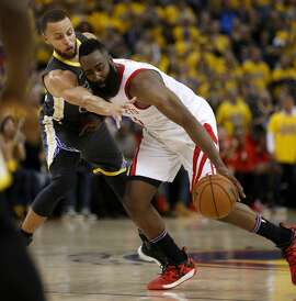 OAKLAND, CA - MAY 22: Houston Rockets' James Harden (13) dribbles the ball against Golden State Warriors' Stephen Curry (30) in the third quarter of Game 4 of the NBA Western Conference finals at Oracle Arena in Oakland, Calif., on Tuesday, May 22, 2018. (Nhat V. Meyer/Bay Area News Group via Getty Images)
