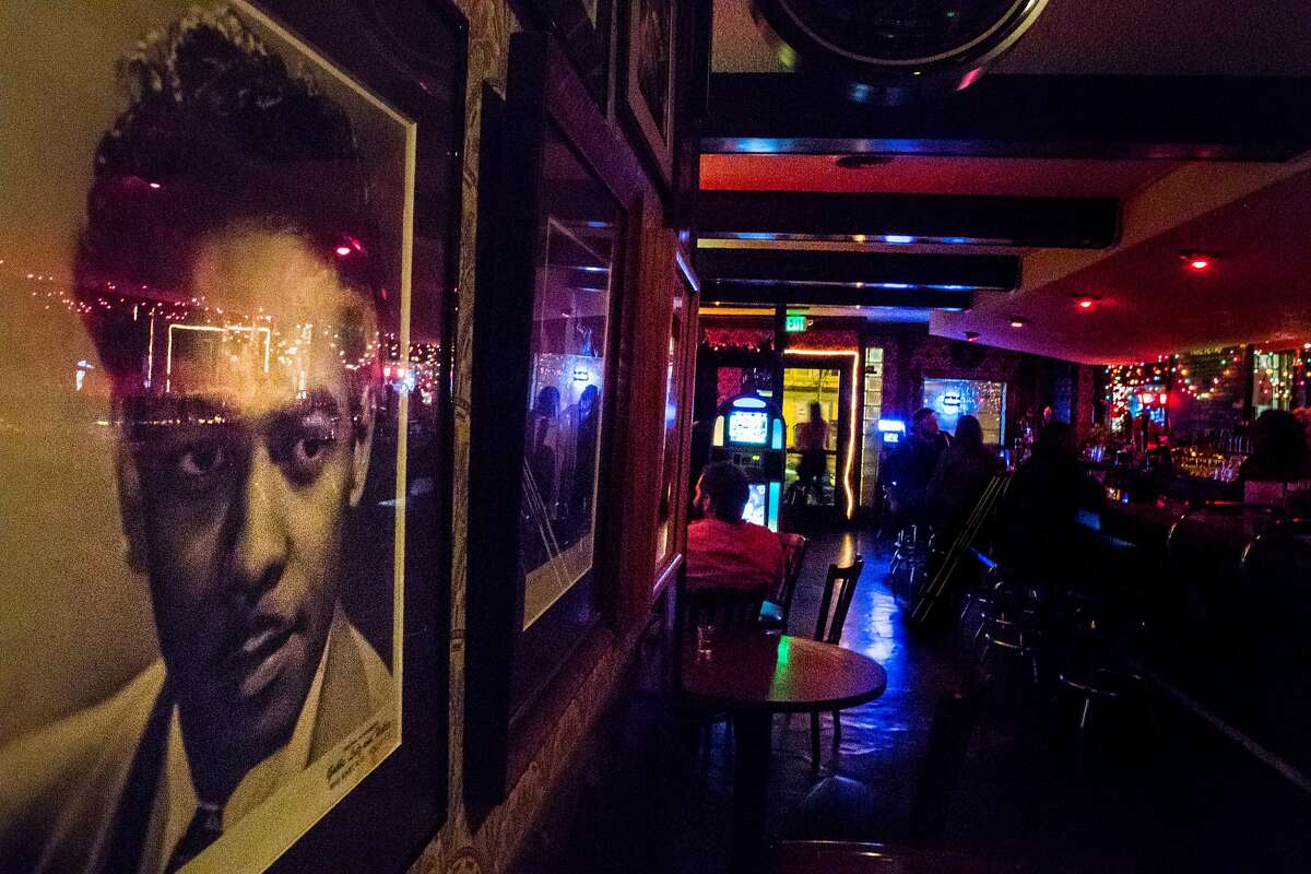 A photo of Gene Gilbeaux hangs among other jazz greats who performed at Club Waziema on Wednesday, Sept. 5, 2018, in San Francisco, Calif.
