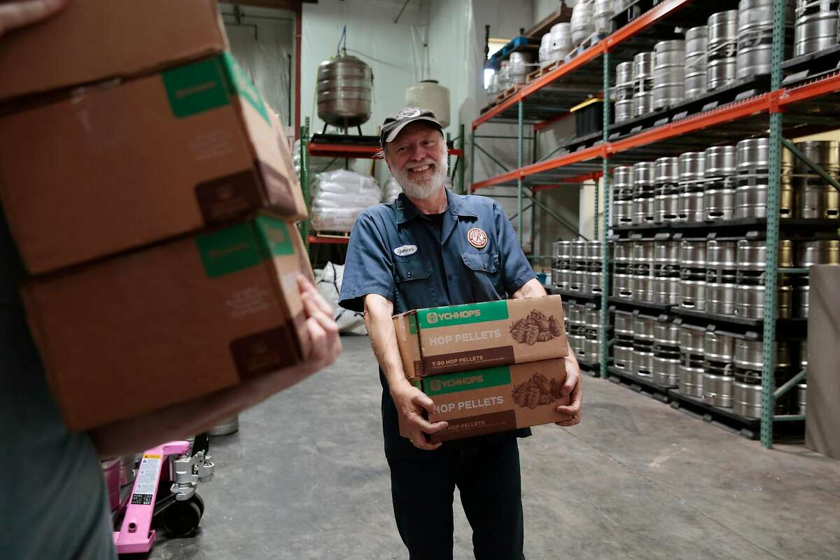 Moonlight Brewing Company founder and brewmaster helps carry boxes of hop pellets into a walk-in refrigerator in Santa Rosa, California, Friday, August 31, 2018. Moonlight opened a new taproom attached to the brewery a few months ago. Ramin Rahimian/Special to The Chronicle