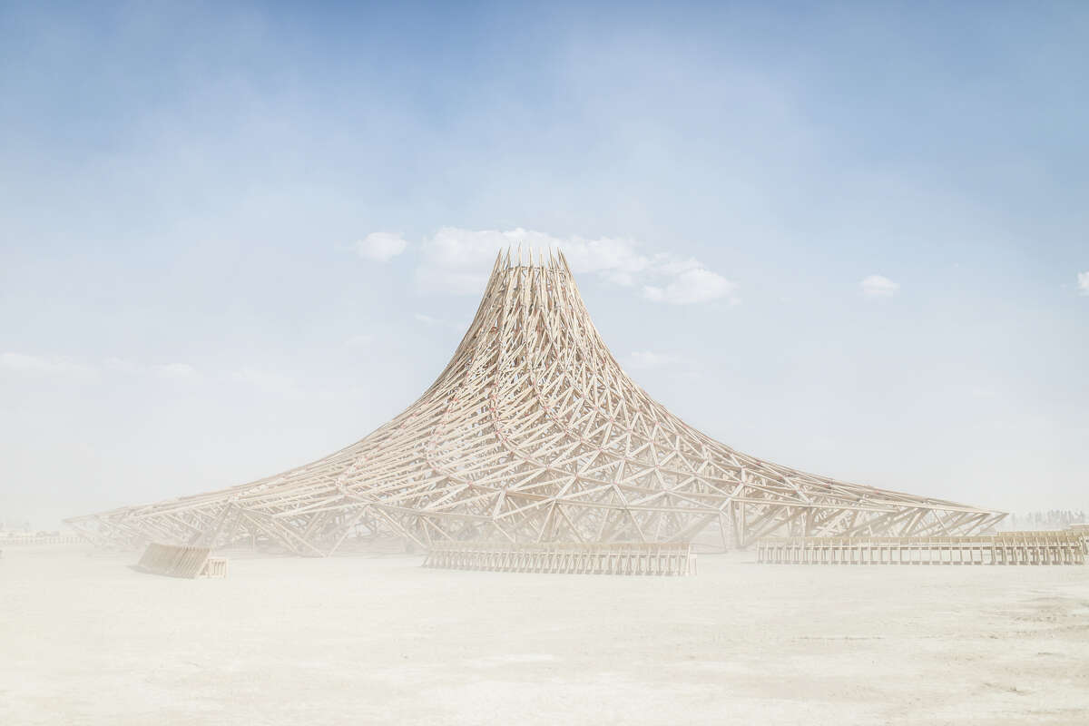 The temple at Burning Man is meant to be a place for anyone to go and release, mourn, or celebrate someone or something important in their life. The structure is burned at the end of the week after the man burns.