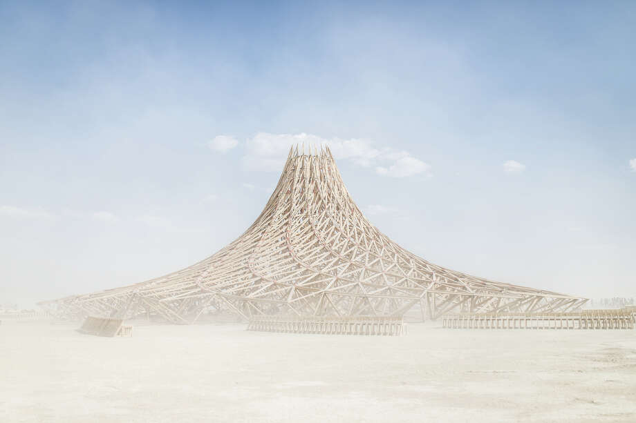 The temple at Burning Man is meant to  be a place for anyone to go and release, mourn, or celebrate someone or something important in their life. The structure is burned at the end of the week after the man burns. Photo: Jane Hu / Burning Man