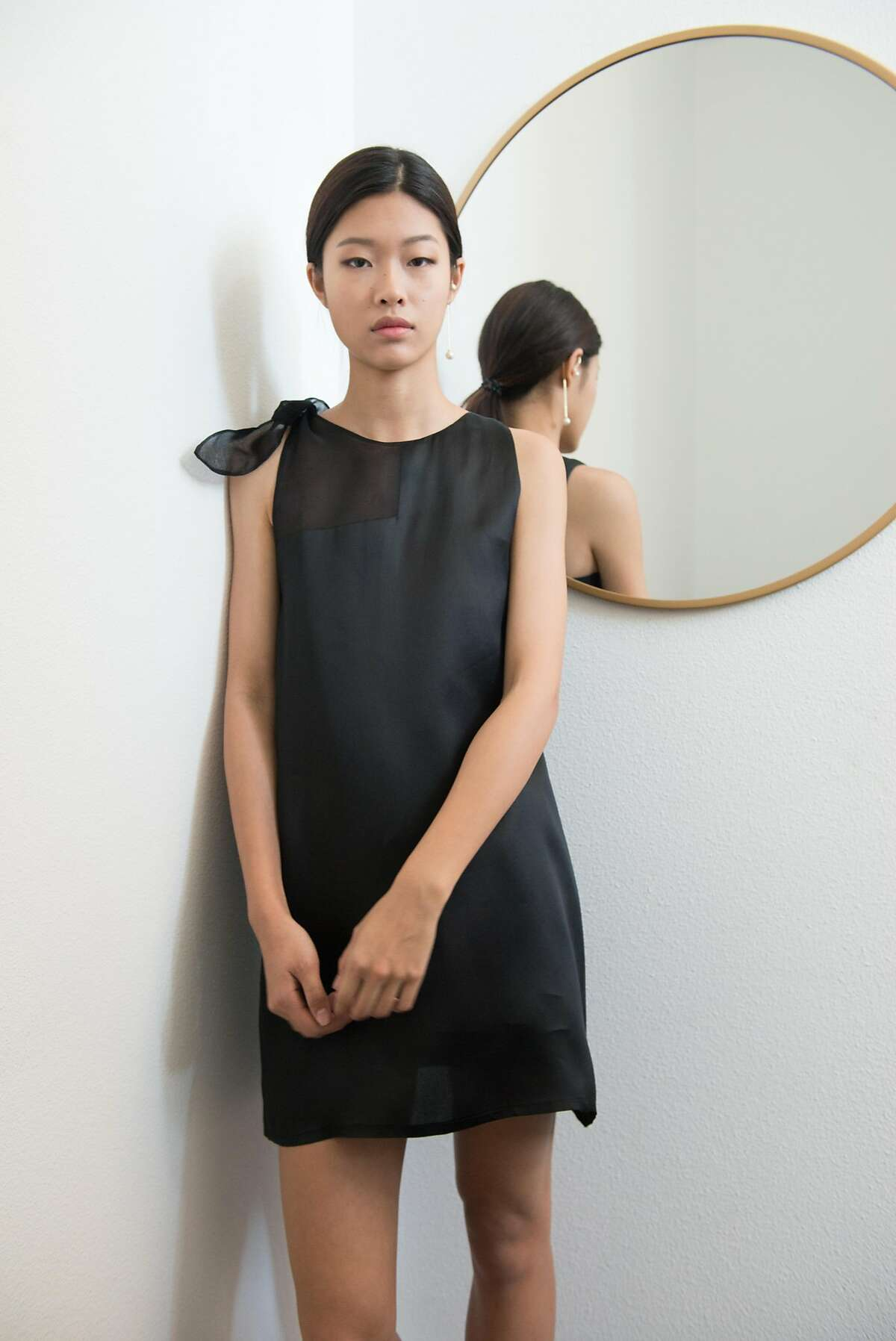 Joanne Lu's�black Patchwork silk dress ($328) for her�Mute by JL is�silk and French organza frock.