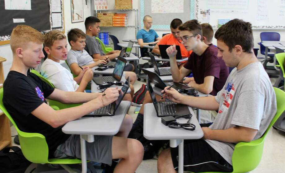 Students at Lewis S. Mills High School received new computers this year, part of a new program focused on providing support and advanced technology in the classroom. Photo: /