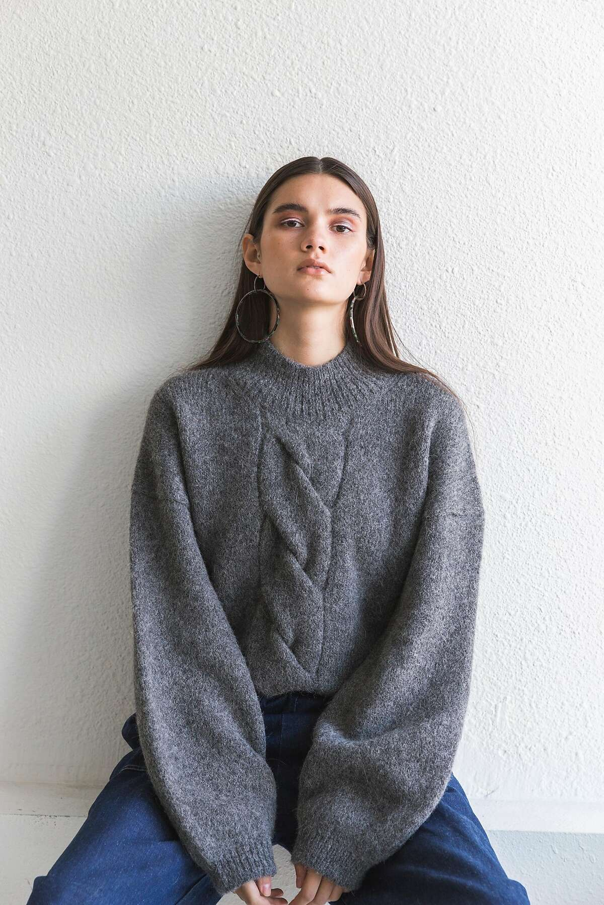 The Melange Grey Twist cable sweater ($363) as a twist on a classic big cable sweater.