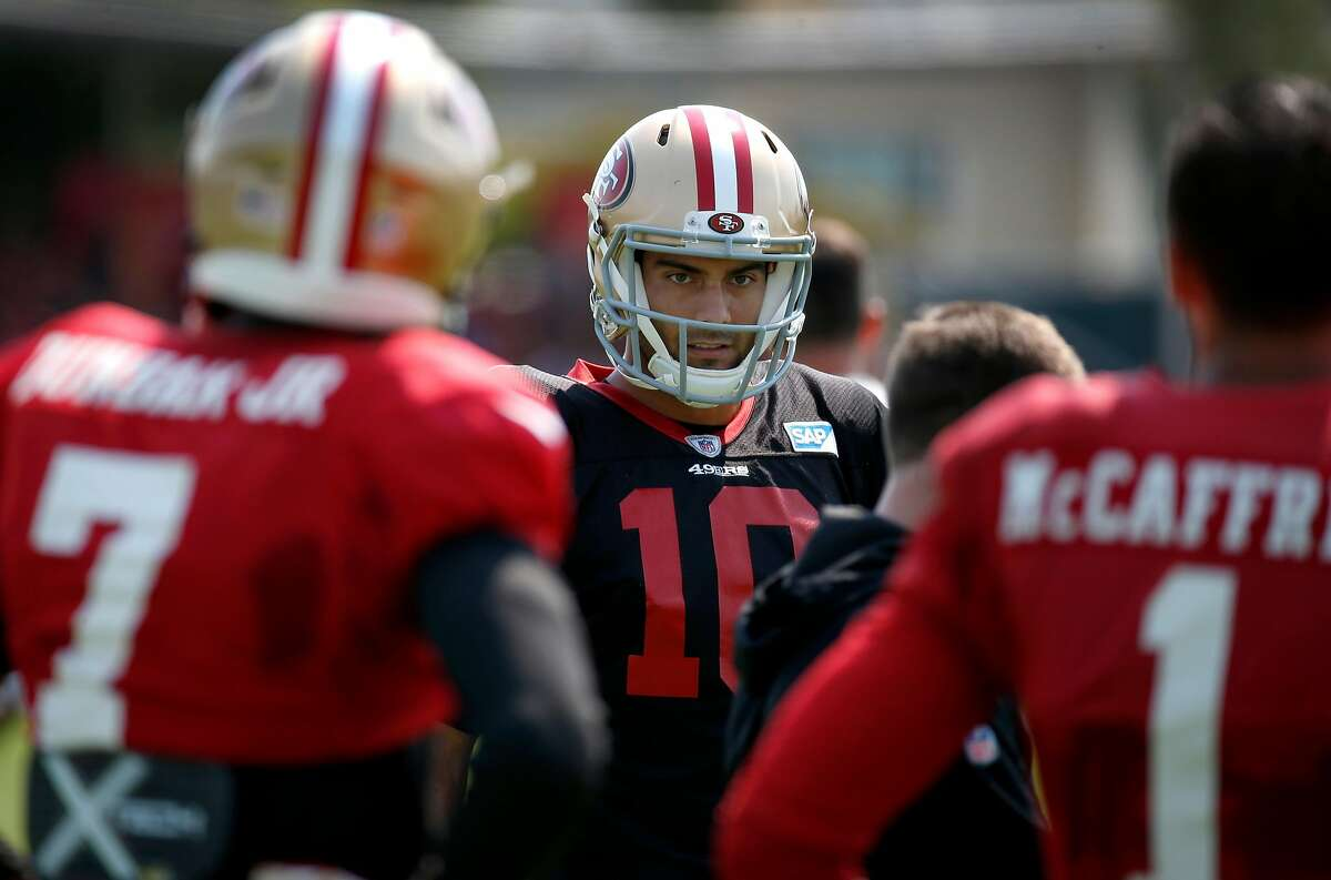 Starter Jimmy Garoppolo meets with other quarterbacks at the San Francisco 49ers training camp in Santa Clara, Calif. on Saturday, July 28, 2018.