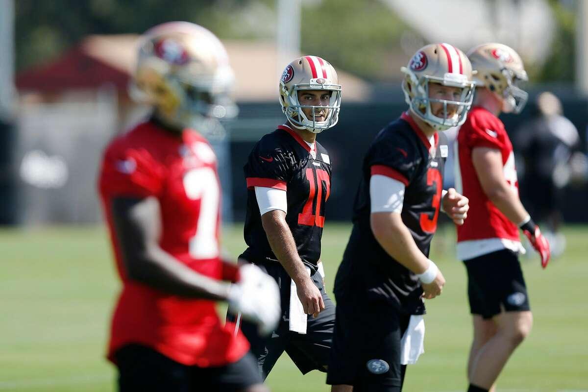 49ers quarterback Jimmy Garoppolo (10) practices at training camp at Levi's Stadium on Thursday, July 26, 2018 in Santa Clara, Calif.