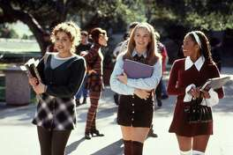 CLUELESS (1995) - Brittany Murphy, Alicia Silverstone, Stacey Dash. HOUCHRON CAPTION (08/10/2004): ``CLUELESS'': Alicia Silverstone, center, charmed audiences with her turn as a Beverly Hills teenager who wasn't as superficial as she seemed.