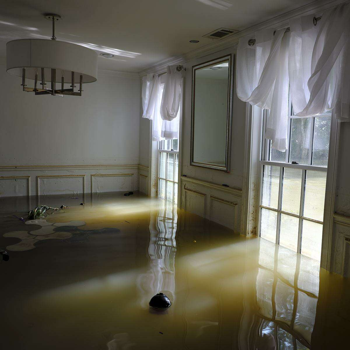 """Gideon Mendel's """"The home of David Lim, Rancho Bauer Drive, Memorial Neighborhood, Houston, Texas,"""" shot last September, is among works on view in """"Deluge,"""" one of several flood-based shows on view at FotoFest Sept. 6-Nov. 3. About 50 images by Houston Chronicle photographers are featured with photos from the community in the other show, """"Seeing Harvey."""""""