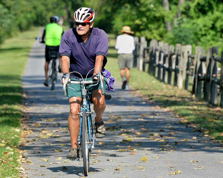 Dennis Locke of Schenectady beats the heat by getting his daily ride in early in the day and by wearing proper clothing Wednesday Sept. 5, 2018 in Niskayuna, NY.  (John Carl D'Annibale/Times Union) Photo: John Carl D'Annibale, Albany Times Union / 20044737A