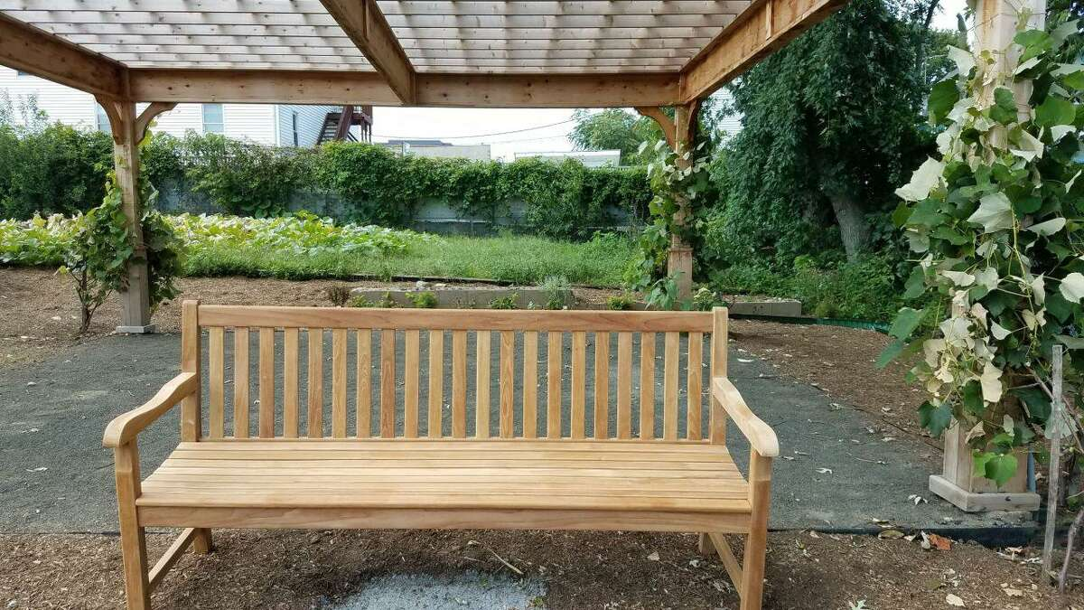 One of the six teak benches that will adorn Anthony's Arbor, a pergola constructed in honor of late Stamford resident Anthony Pellicci, at Fairgate Farm. The farm is hoping to raise enough funds to purchase all six benches as permanent seating at the location.