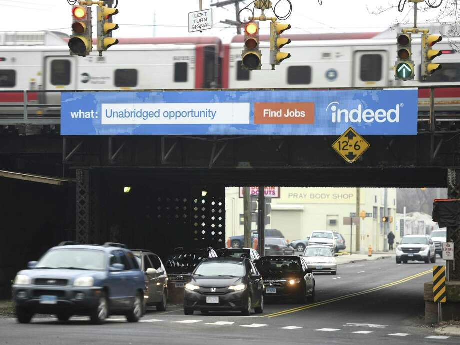 A billboard for Indeed, an online job search website, hangs on the Elm Street Metro-North overpass in Stamford. Photo: Tyler Sizemore / Hearst Connecticut Media / Greenwich Time