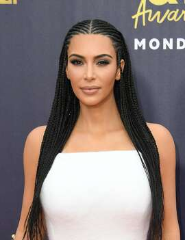 (FILES) In this file photo taken on June 16, 2018 US TV personality Kim Kardashian attends the 2018 MTV Movie & TV awards, at the Barker Hangar in Santa Monica. - Kim Kardashian on September 5, 2018 made her second visit to the White House this year to talk criminal justice, months after she successfully appealed for the release of a great-grandmother convicted of cocaine trafficking.The reality TV star was one of around 50 people, including US President Donald Trump's son-in-law and advisor Jared Kushner, set to discuss the clemency process, the White House said in a statement. (Photo by VALERIE MACON / AFP)VALERIE MACON/AFP/Getty Images