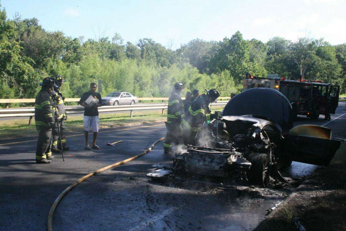 Fire officials are investigating the cause of an early morning car fire on the Merritt Parkway that destroyed an Audi R8 belonging to a Connecticut Powerball winner.