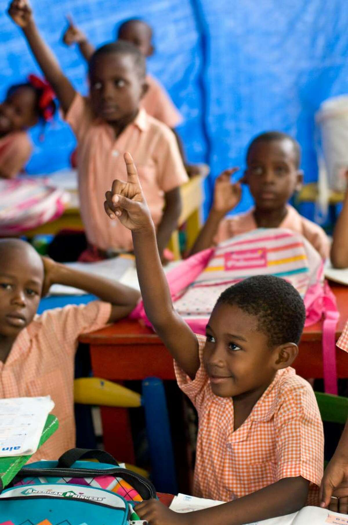 First grader Blaise Mihelitchy raises his hand at the Eddy Pascal school. Ecole Eddy Pascal was a cornerstone of the local community in Carrefour, Haiti, for over 25 years. Housed in an imposing three-story building, Ecole Eddy Pascal offered elementary and secondary school, classes for adults and a cultural club for the community. But the facility collapsed on January 12, and the school director, Eddy Pascal himself, began searching for a way to start over.