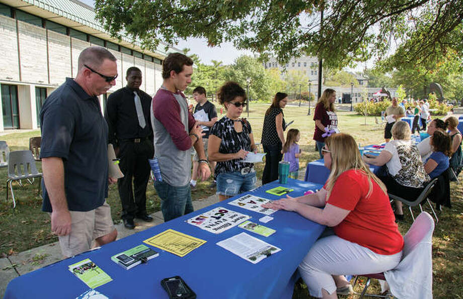 Students and their families discuss financial aid options with L&C staff during Lewis and Clark Community College's Fall 2017 Discover Day event. Photo courtesy of Lewis and Clark Community College Photo: For The Intelligencer