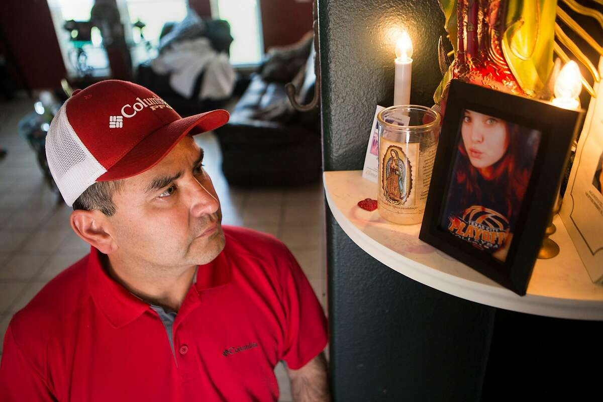 Raul Vela, is the father of 18-year-old Brandy Vela, who killed herself Nov. 29 and suffering a year of cyber bullying. Vela stands by a statue of the Virgin of Guadalupe and a photograph of his daughter, Friday, March 17, 2017, in Texas City.