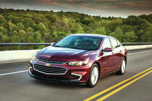 This undated photo provided by General Motors shows the 2018 Chevrolet Malibu Hybrid. The vehicle offers noise-reducing side windows, Apple CarPlay and in-car Wi-Fi.