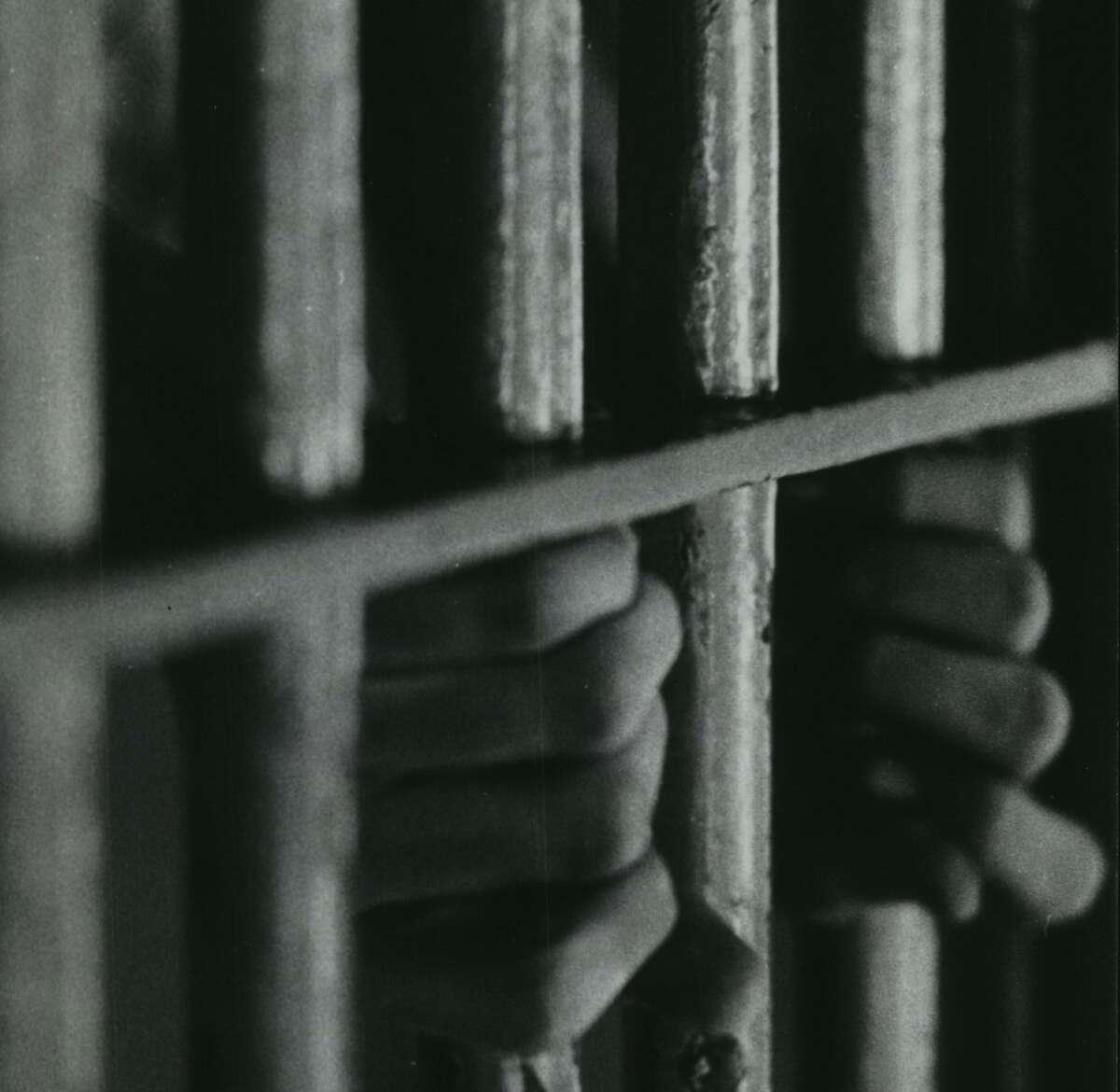 Man behind bars at Houston City Jail. Police Department - Police Station and City Jail. Houston, Texas.