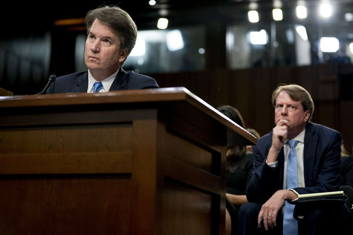 President Donald Trump's Supreme Court nominee, Brett Kavanaugh, a federal appeals court judge, left, accompanied by White House counsel Don McGahn, right, testifies before the Senate Judiciary Committee on Capitol Hill in Washington, Wednesday, Sept. 5, 2018, for the second day of his confirmation to replace retired Justice Anthony Kennedy. (AP Photo/Andrew Harnik)