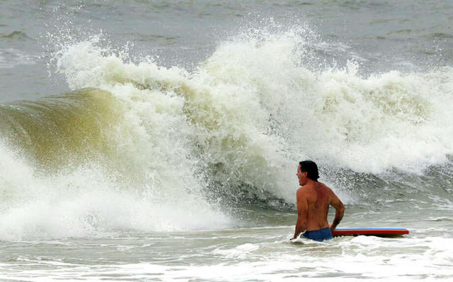 Chris Stebly tries to catch some waves as Tropical Storm Gordon heads toward the coast of Alabama on Tuesday. Photo: Dan Anderson | AP