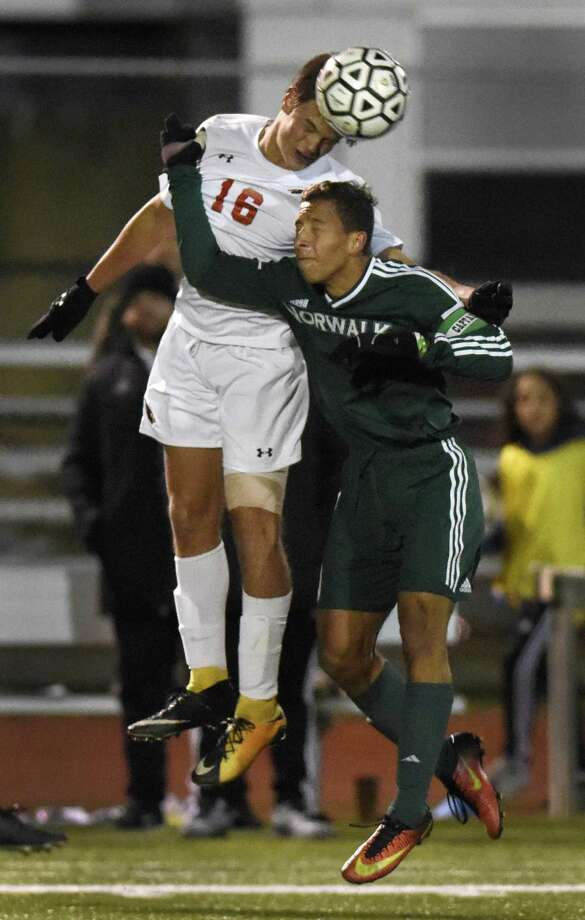 Greenwich's Francisco Liguori, left, and Norwalk's Sebestian Echeverri jump for a header in the FCIAC high school boys soccer semifinal game between Greenwich and Norwalk at Fairfield Ludlowe High School in Fairfield, Conn. Monday, Oct. 30, 2017. Photo: Tyler Sizemore / Hearst Connecticut Media / Greenwich Time
