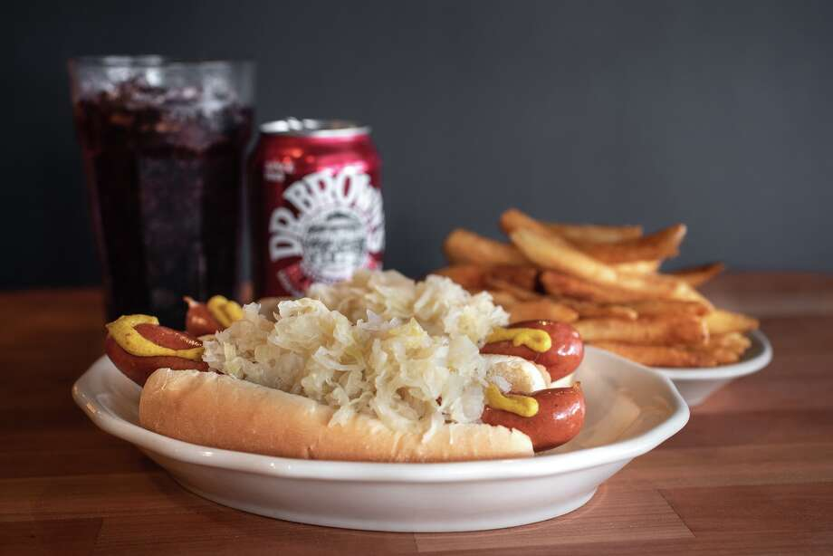 PHOTOS: A new dog in townKenny & Ziggy's owner Ziggy Gruber has replaced the hot dogs on his menu with a new all-beef, natural-casing frank made to his specifications. >>Learn more about the Kenny & Ziggy's new hot dog ... Photo: Deb Smal, Deb Smail