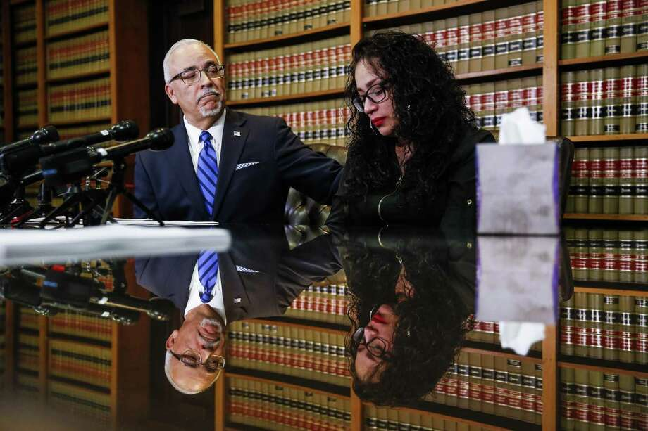 Abraham, Watkins, Nichols, Sorrels, Agosto and Aziz partner Benny Agosto Jr. comforts Michele Pena as they discuss a lawsuit against Pena's husband's former employer, Ben E. Keith Company, Wednesday Sept. 5, 2018 in Houston. Pena's husband, Francisco Joel Reyes, was killed at work when a woman entered the food warehouse in Missouri City and started shooting on Aug. 21, 2018. The lawsuit alleges that the company failed to secure their premises and adequately protect their employees. Photo: Michael Ciaglo, Houston Chronicle / Staff Photographer / Michael Ciaglo