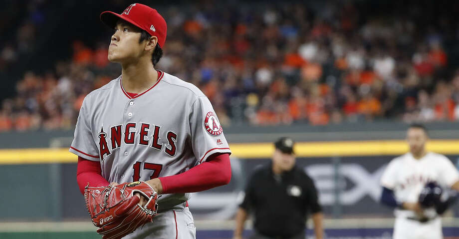 Los Angeles Angels starting pitcher Shohei Ohtani (17) walks back to the dugout after striking out Houston Astros Tyler White to end the first inning of an MLB baseball game at Minute Maid Park, Sunday, September 2, 2018, in Houston. Photo: Karen Warren