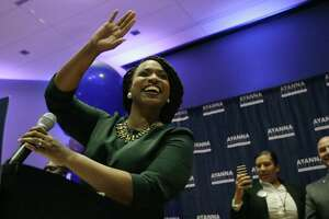 Boston City Councilor Ayanna Pressley celebrates victory over U.S. Rep. Michael Capuano, D-Mass., in the 7th Congressional House Democratic primary in Boston on Tuesday.