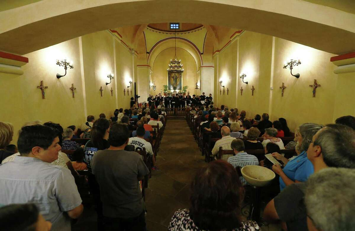 Members of the San Antonio Choral Society perform in the chapel of Mission Concepcion as part of the World Heritage Site Celebrations on Friday, Oct. 16, 2015. The San Antonio Office of Historic Preservation hosted the event featured a light projection on the mission of how it originally looked according to officials. Guests were also treated to tours around the mission, music and food. (Kin Man Hui/San Antonio Express-News)