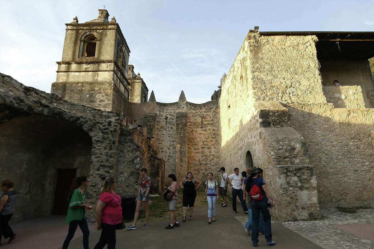 Guests take a walking tour outside Mission Concepcion as part of the World Heritage Site Celebrations on Friday, Oct. 16, 2015. The San Antonio Office of Historic Preservation hosted the event which featured a light projection on the mission of how it originally looked according to officials. Guests were also treated to tours around the mission, music and food. (Kin Man Hui/San Antonio Express-News)