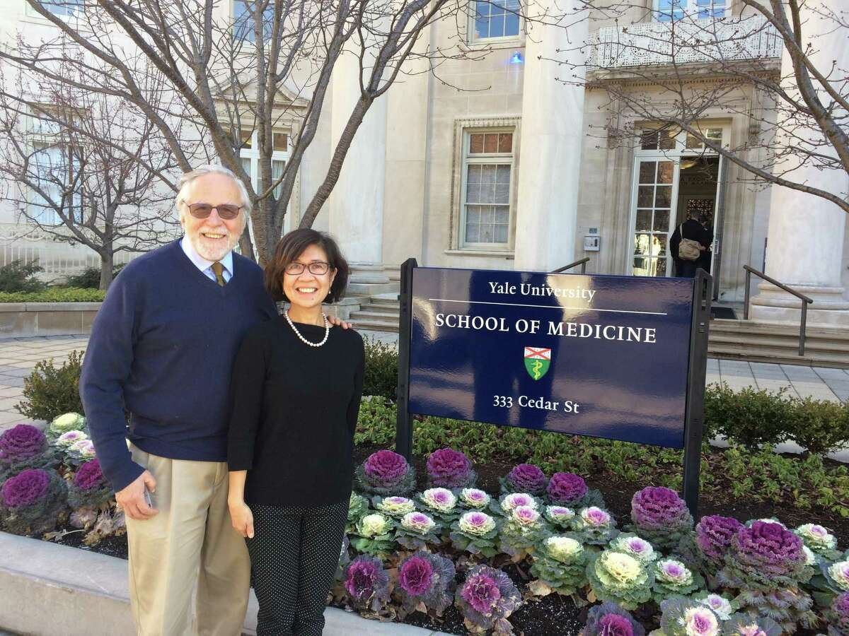 The Yale HIV/AIDS Program's current director, Dr. Merceditas Santos Villanueva, right, poses with her predecessor, Dr. Gerald Friedland, who headed the program from 1991 to 2010.