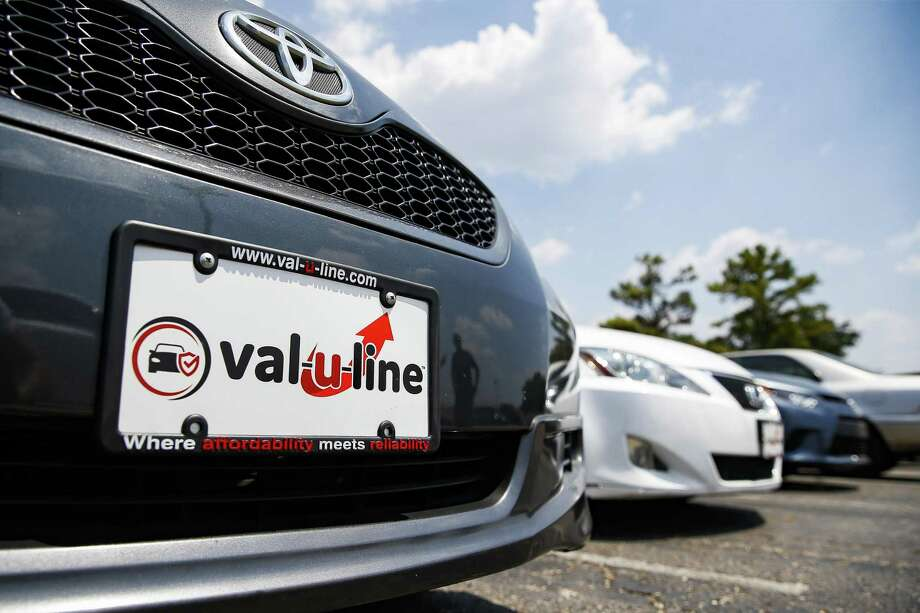 A car sits on the Val-U-Line at Sterling McCall Toyota, a Group 1 Auto dealership, which posted record sales, driven in part by strong used car sales Thursday July 26, 2018 in Houston. (Michael Ciaglo / Houston Chronicle) Photo: Michael Ciaglo, Staff Photographer / Houston Chronicle / Michael Ciaglo