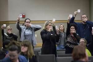 About 50 minutes before midnight, parents pressure the panel of representatives from the U.S. Department of Education's Office of Special Education and Rehabilitative Services (OSERS) and the Texas Education Agency (TEA) to extend a hearing about special education, Thursday, Dec. 15, 2016, in Austin. ( Marie D. De Jesus / Houston Chronicle )