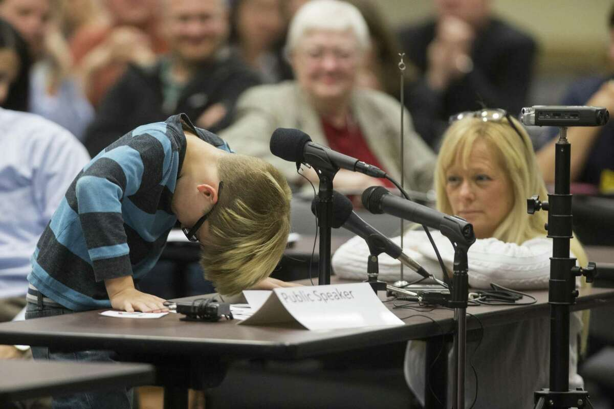 Chris Crowley struggles to talk about his issues at school. His mother Camilyn Marceaux, right, also spoke to the representatives from the U.S. Department of Education's Office of Special Education and Rehabilitative Services (OSERS) and the Texas Education Agency (TEA) about special education hearing, Monday, Dec. 12, 2016, in Houston. ( Marie D. De Jesus / Houston Chronicle )
