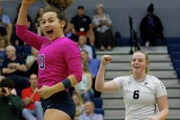 College Park?'s Jill Bohnet (10) reacts after a point in front of Annie Cooke (6) during a District 15-6A high school volleyball match at College Park High School on Tuesday, Sept. 4, 2018, in The Woodlands.