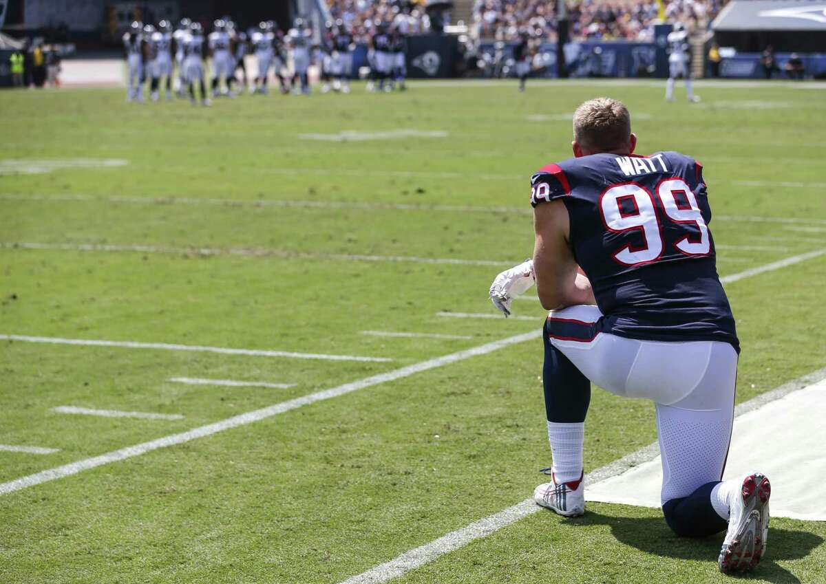 Houston Texans defensive end J.J. Watt (99) kneels on the sidelines watching the first quarter of an NFL preseason football game against the Los Angeles Rams at the Los Angeles Memorial Coliseum on Saturday, Aug. 25, 2018, in Los Angeles.