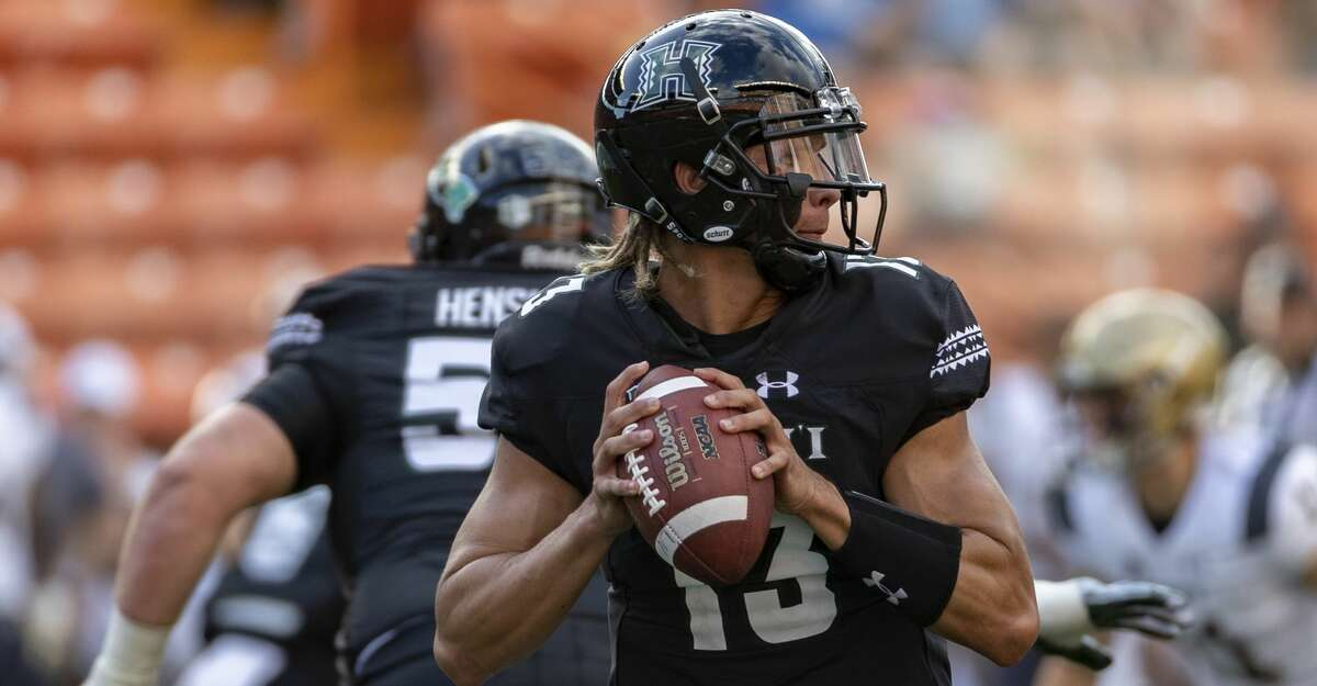 Hawaii quarterback Cole McDonald (13) looks for an open receiver to pass to in the first half of an NCAA college football game, Saturday, Sept. 1, 2018, in Honolulu. (AP Photo/Eugene Tanner)