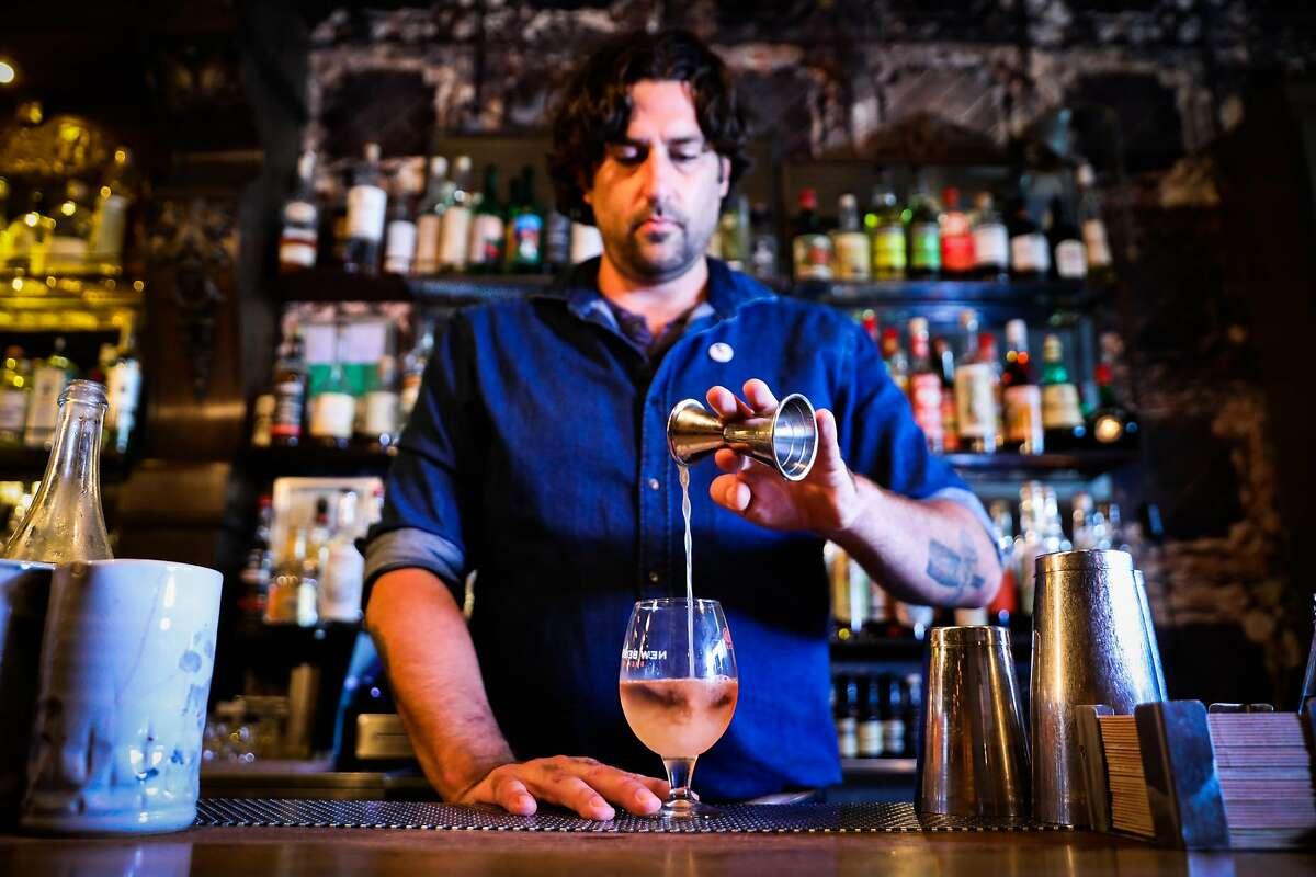Bar manager Matt Grippo makes the Froz� All Day drink at Blackbird bar in San Francisco, California, on Thursday, July 26, 2018.