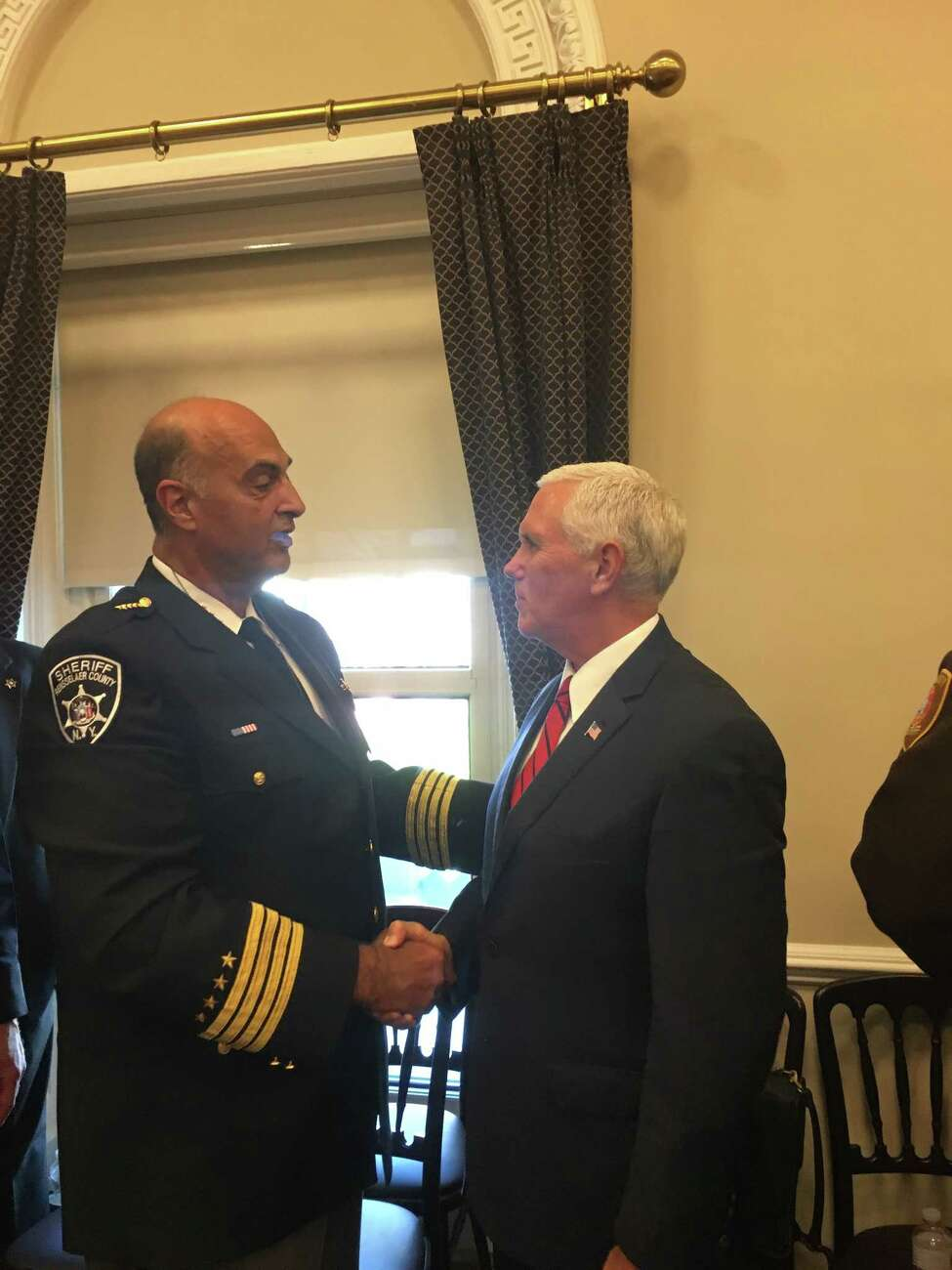 Rensselaer County Sheriff Patrick Russo shakes hands with Vice President Mike Pence at the White House, Washington D.C. Wednesday Sept. 5, 2018.