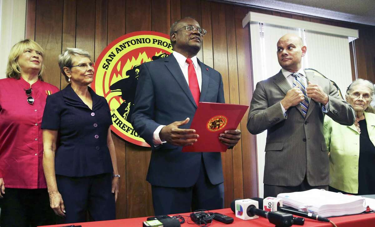 San Antonio Professional Firefighters president Chris Steele speaks as Union leaders hold a press conference to unveil the next steps in their Charter-amendment campaign on September 5, 2018. Behind are (from left) are Nikki Kuhns, Reinette King, attorney Cris Feldman and Betty Eckert.